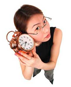 a woman listening to a clock tick
