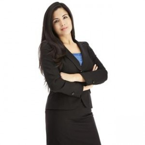 a businesswoman standing with arms crossed